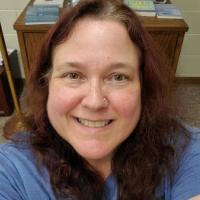 Lisa Mikkelson,  The Spirited Medium
